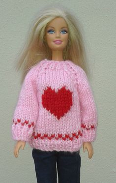 Crochet Toy Barbie Clothes The design has raglan sleeves and back fastening for an easy fit. The motif is worked using intarsia method - if you' re new to this there are lots of tutorials online. Barbie Knitting Patterns, Knitted Doll Patterns, Jumper Knitting Pattern, Knitting Dolls Clothes, Knitting Toys, Free Knitting, Crochet Barbie Clothes, Doll Clothes Barbie, Barbie Dress