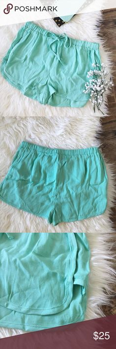 """nwt//kendall+kylie • mint flowy drawstring shorts ▫️kendall + kylie  ▫️mint green flowy shorts ▫️drawstring and elastic waist ▫️no pockets ▫️size: medium ▫️measurements:        •waist laying flat: 14"""" (can stretch bc of elastic waist)        •inseam: 1.5""""        •total length from waist: approx 11.5"""" ▫️condition: new with tags •please see all pics, read description, and ask questions before purchasing  •no trades• Kendall & Kylie Shorts"""