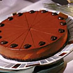 Chocolate Truffle Cheesecake- Serves 16     Sometimes we even stun ourselves. This ultra-rich and creamy chocolate cheesecake has less than 10 grams of fat per slice, making it one of our all-time best successes. We replaced the full-fat cream cheese in the original with pureed cottage cheese and reduced-fat cream cheese. To achieve a rich chocolate flavor, we used cocoa powder enhanced by a small amount of high-quality chocolate instead of 12 ounces chocolate chips.