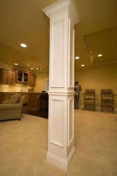 Basement - Classy way to hide the support beams!