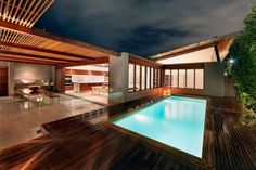 Wood Interiors and Exterior in Warmth Home Architecture - Swimming Pool. CplusC Architects.