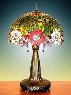 the colors featured in this Tiffany Lamp (yellow green leaves, red flower, and blue singular bead) are a standard triadic scheme Tiffany Stained Glass, Stained Glass Lamps, Tiffany Glass, Leaded Glass, Antique Lamps, Vintage Lamps, Vintage Lighting, Art Nouveau, Glass Art