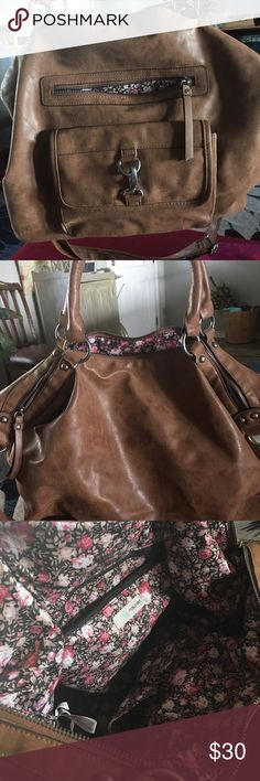 Leather brown bag/purse Will function as a purse or bag- can easily hold small laptop or iPad. Has two outside pockets for phone and accessories and one side pocket inside. Purchased at Maurice's, daughter never used. Excellent condition, NO wear and tears. Maurices Bags Shoulder Bags