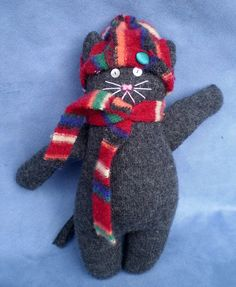 sweater cat in hat and scarf