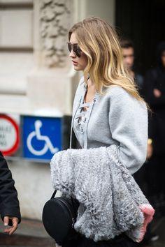 Gigi Hadid in Isabel Marant sweater and Rag & Bone bag   - HarpersBAZAAR.com