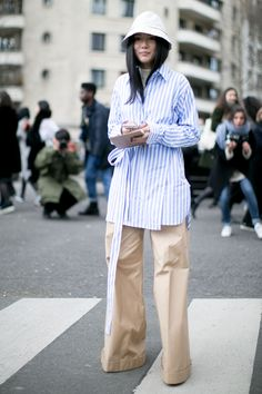 Street Style_stripe classic shirt paired with straight leg pants | Saved by Gabby Fincham | Paris Fashion Week Fall 2016