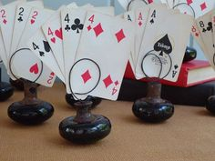 wedding center peices using door knobs | Use old doorknobs to hold playing cards. Ingenious!