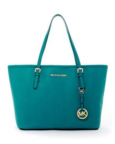 Loving this teal travel tote by Michael Kors. Pretty sure I'd freak out if I opened this for Christmas! (Someone tell my husband!) lol