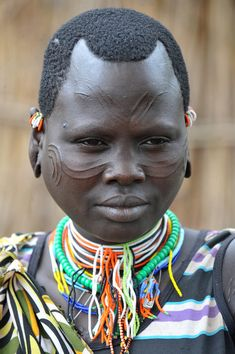 Africa | Kachipo girl with facial scarification. South-eastern South Sudan, on the plateau east of Boma, towards the Ethiopian border. | © Geert Henau