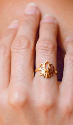 Gold monogram ring.