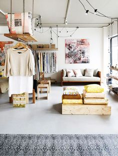 Hanging shelf with bar + clothes