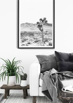 There is something so beautifully romantic about a desert landscape. The Joshua Tree Desert Print has a lovely aged vintage quality to it and the black and white colour palette allows it to work easily within a range of interiors. Modern Boho Prints | Southwestern Boho Decor | Desert Home Decor | California Desert Wall Art | Modern Bohemian Art | Modern Boho Interior | Modern Boho Living Room | Black and White Desert Print | Joshua Tree Photography | Coastal Boho Bohemian Wall Decor, Bohemian Art, Southwestern Boho Decor, Decoration Cactus, Black And White Wall Art, Tree Photography, Boho Living Room, Tree Print, Modern Boho