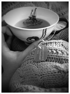 snuggled on the couch with some hot tea under a cozy blanket