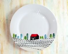 Hand painted decorative plate - Red roof hut in a landscape with snowflakes
