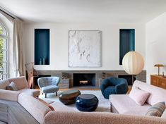 An artwork by David Altmejd hangs over the travertine fireplace in the living room. Assis(asy)métrie armchair by Pierre Yovanovitch; Mongolfiera floor lamp by Paola Napoleone. Living Room Modern, Living Room Decor, Living Spaces, French Interior, Modern Interior, Living Room Inspiration, Interior Design Inspiration, Interior Exterior, Interior Architecture