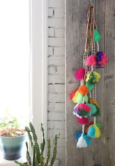 Tassel love. Hang these up in your home for a pop of colour. Choose bright coloured yarn and decorate your bedroom. Great for teens!