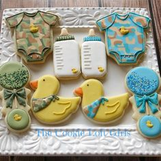 Cookies made by me and my sis-in-law for a baby shower with teal/camo/duck theme. Camo Cookies, Duck Cookies, Baby Boy Cookies, Onesie Cookies, Baby Shower Cookies, Sugar Cookies, Camo Baby Cake, Baby Boy Camo, Camo Baby Stuff