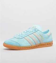 adidas Originals Hamburg: Initially released in 1982 as part of adidas' now legendary City Series, the shoe has returned two decades after its steady rise to becoming one of the most popular street-ready silhouettes during the football-casual movement through Europe in the early 80s. This colourway is presented in a frost blue suede upper with off white suede three stripe branding plus an off white suede branded heel tab and is sat on a gum midsole and finished
