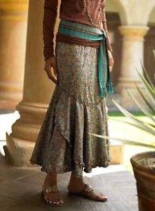bohemian - love the way the belt is done - very much my style.  Whole outfit is great especially the colours.
