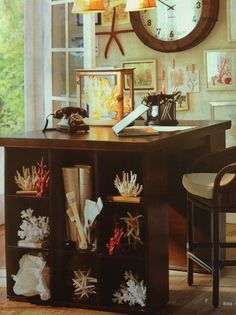 Great options for shelving with seashells/naturals! Tall desk/island with square shelves from Pottery Barn