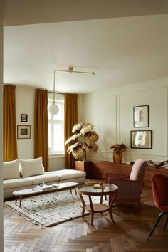 Prewar Modern House Tour with Elegant Parisian Touches stunning golden hues and warm tones in this midcentury inspired living room Living Room Designs, Living Room Decor, Living Rooms, Decoration Design, Modern Interior Design, Contemporary Interior, Apartment Living, Apartment Interior, Room Interior