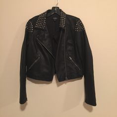 Topshop (faux) leather jacket Topshop faux leather jacket with grommets on the collar and shoulder area. Worn less than a handful of times; great condition. Topshop Jackets & Coats
