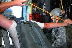 """As an instructor watches for the drop zone to come into view, U.S. Army Cadet Ema Gondkavska prepares to parachute jump out of the door of a C-130 overlooking Chattahoochee Valley July 21, 2009. Gondkavska, a student with Company B of the U.S. Army Airborne School, said as she stood in front of the door she felt """"ready to go for it."""" (U.S. Army photo by Kristin Molinaro) (RELEASED)"""
