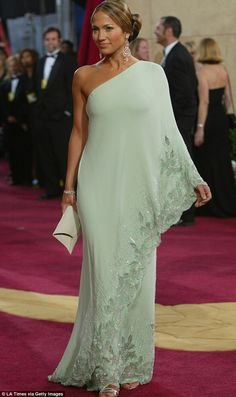 Lucky: Jennifer Lopez's mint green gown at the Oscars in 2003 had previously been owned by Jackie O As the annual couture fashion parade that is the Academy Awards approaches, we take a look back at some of the most memorable gowns of all time. Trendy Dresses, Elegant Dresses, Vintage Dresses, Fashion Dresses, Formal Dresses, Wedding Dresses, Vintage Dior, Office Dresses, Casual Dresses