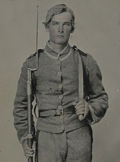 Impossibly handsome unidentified soldier in Confederate uniform with musket and D-guard Bowie knife