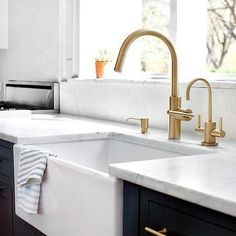 Navy Blue Shaker Cabinets with Farmhouse Sink
