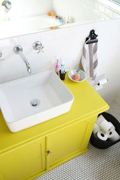 A bright vanity adds a fun twist in this kids bathroom.