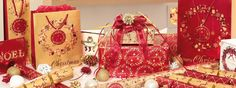 Tom Smith Since 1847   The Home of Christmas Take a look at our luxurious red and gold range - perfect for a festive feast and all available to view on our website.