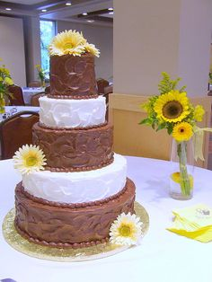 Stucco iced Chocolate Butter Cream wedding cake garnished in sunflowers