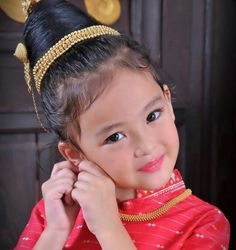 Cute little girl in traditional Laos costumes