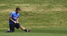 Adem Ljajic doing stretches