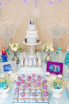 Frozen themed birthday party with Such Fun Ideas via Kara's Party Ideas | Cake, decor, cupcakes, favors, printables, games, and more! KarasP...