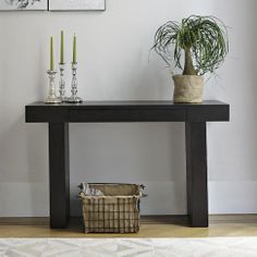 Terra Console | west elm $350  Strong, simple and sustainable. A west elm green product, the Terra Console is made from durable wood finished with recycled-aluminum hardware and water-based stain and glues. This multifunctional console table can also be used as a space-saving desk.
