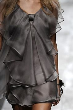 I see an easy slip dress with wave ruffle embellishment. Probably doable. Maybe in a turquoise.