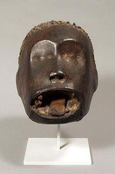 Head. West Africa, Nigeria: Ejagham or related tribe. 20th century. Wood, skin, hair, animal teeth, metal. h. 18.0 cm. Acquired 1975. Robert and Lisa Sainsbury Collection. UEA 602. www.scva.ac.uk