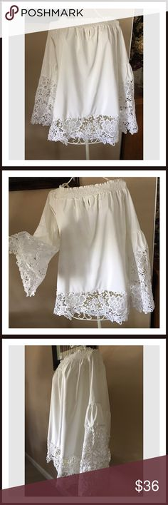 "🆕Cold Shoulder White Lace Top Plus Size This plus size off the Shoulder Top is just gorgeous. White off the Shoulder Top with beautiful white Lace on the sleeves and around the hemline. It is marked 5x but The measurements are as follows. From armpit to armpit measures 26"". From shoulder to hemline measures 29"". All measurements are approximate. Boutique Tops Blouses"