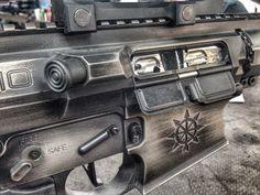 Cerakote Coatings: H-170 Titanium with H-190 Armor Black