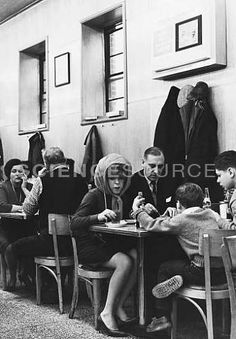 """A family shares a meal at Katz's Deli on Delancey Street, New York City. Circa 1964. The photograph is captioned: """"Jewish deli, Delancey Street, Fall 64"""". ©Bernard Pierre Wolff/Photo Researchers, Inc. #KatzDeli #NYC #lunch #family #historicphoto #stockimages #ScienceSource"""