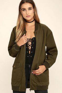 The Light Beam Olive Green Oversized Bomber Jacket will keep you perfectly on-trend! This classic bomber has been given a chic upgrade with an oversized fit and a canvas construction. A ribbed collar sits above an antiqued gold front zipper framed by two large front snap pockets. Long sleeves have ribbed knit cuffs.
