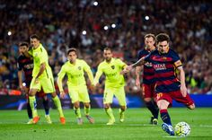 Lionel Messi of FC Barcelona kicks a penalty shot and scores his team's third goal during the La Liga match between FC Barcelona and Levante UD at Camp Nou on September 20, 2015 in Barcelona, Catalonia.