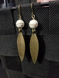 Check out this item in my Etsy shop https://www.etsy.com/listing/560149449/white-howlite-bronze-feather-charm