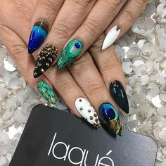 Peacock nail art designs depict beauty and elegance. The most beautiful thing about peacocks is that they have beautiful colorful feathers. Male peacocks tend to display these tail feathers to attract the eyes of female peacocks. If you like peacock Peacock Nail Designs, Peacock Nail Art, Feather Nail Art, Acrylic Nail Designs, Nail Art Designs, Lace Nails, Stiletto Nails, Gel Nails, Nail Pro