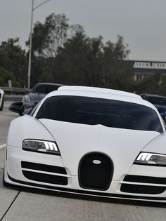 """Bugatti Veyron Pur Blanc - I'm sorry: this car  & model NEVER gets old for me.  Filing this one under """"The tame-looking version that will surprisingly blow their minds when she steps on the accelerator"""" folder, me thinks."""