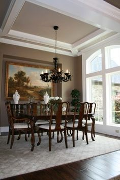 Traditional Dining Room With Sage Green Paint Color Octagon Tray Ceiling Arched Doorway