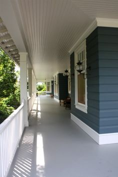 The similarities of this porch to our plans astound me! Even the color of the house and window design is the same!