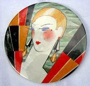 New Page 1 This is an excellent example of Art Deco art in a powder compact made in the early 1920's.